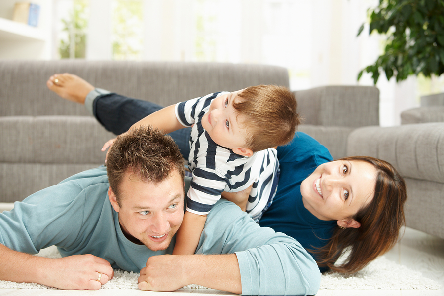 bigstock-Happy-family-playing-at-home--13096373